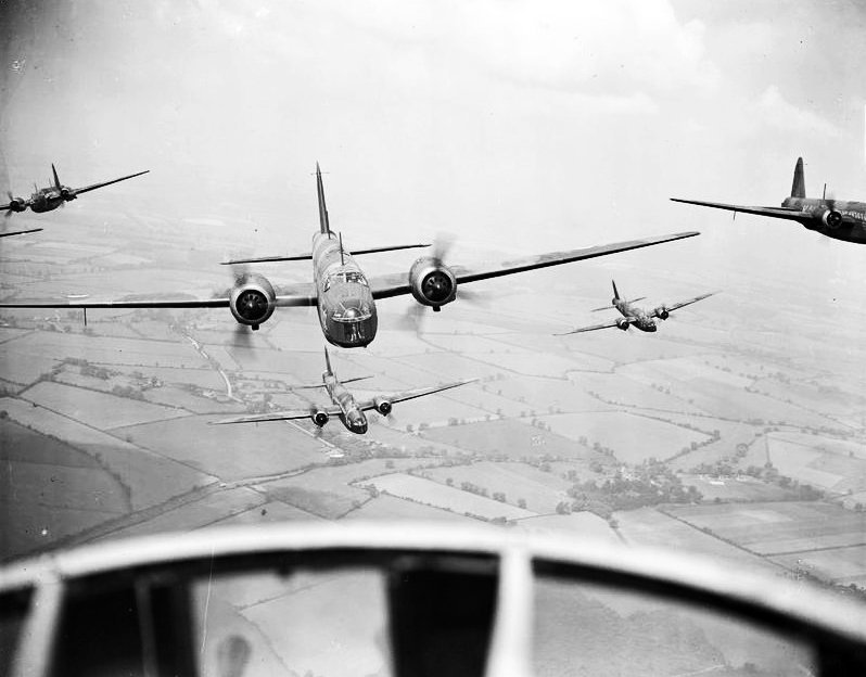 Wellington Bombers flying in formation.